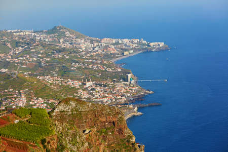 Aerial view of typical Madeira landscape with little villages, terrace fields and mountains