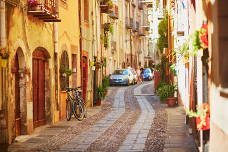 Typical colorful Italian houses on a street of Bosa, Sardinia, Italy Banco de Imagens