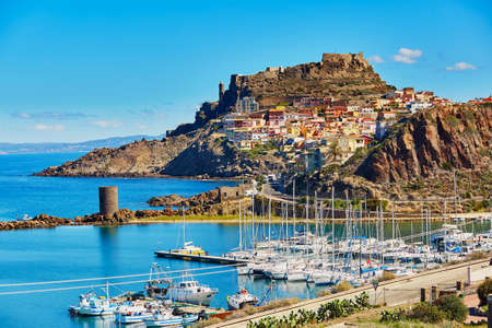Scenic view to Castelsardo village with its castle and marina in Sardinia, Italy