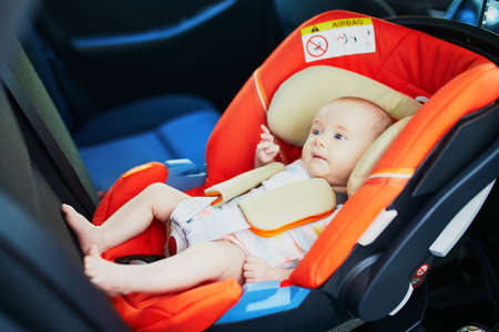 2 month old baby girl in car seat. Safe car trips for infants Banco de Imagens