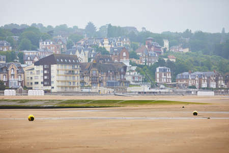 View of Villers-sur-Mer in Lower Normandy, France on a foggy day at low tide 写真素材