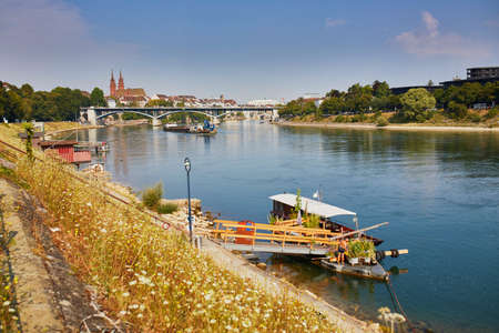 Scenic view of Rhine embankment with ferry boat station in Basel, Switzerland
