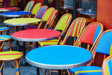 Colorful tables and chairs of empty outdoor cafe in Paris, France Stock fotó