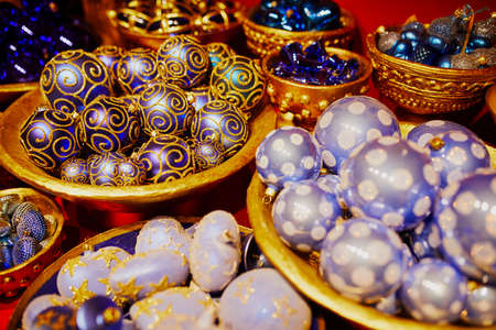 Many glass baubles for Christmas tree. New year decoration on market
