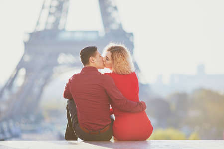 Romantic couple in love near the Eiffel tower in Paris, France Stock Photo