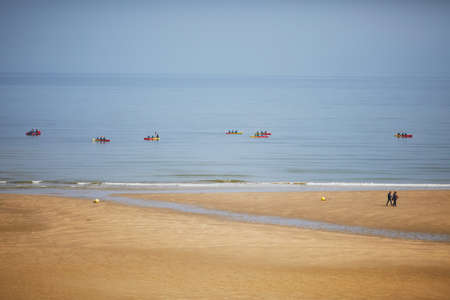 Canoe boats at low tide in Normandy, France Stock Photo