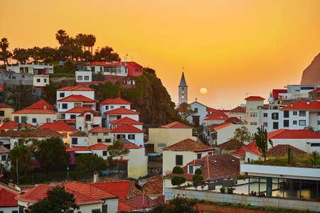 Scenic aerial view of Camara de Lobos village at sunset, Madeira, Portugal