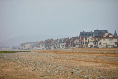 View of Villers-sur-Mer in Lower Normandy, France on a foggy day at low tide Stock Photo