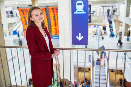 Young woman in international airport Stockfoto