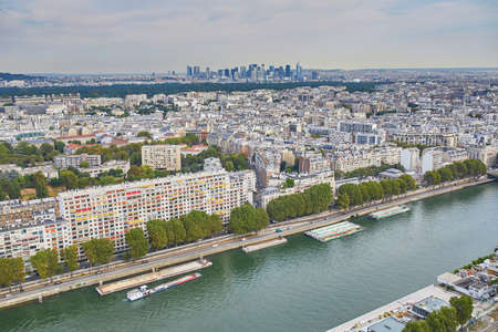 Aerial view of 15th arrondissement of Paris with residential buildings and river Seine, France