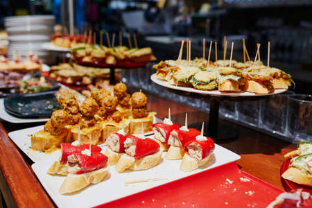 Variety of pinchos (pintxos) in a bar of San Sebastian (Donostia), Spain