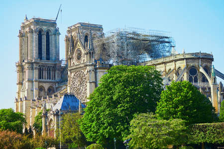View of Notre Dame cathedral without roof and spire destroyed by fire in Paris, France 스톡 콘텐츠