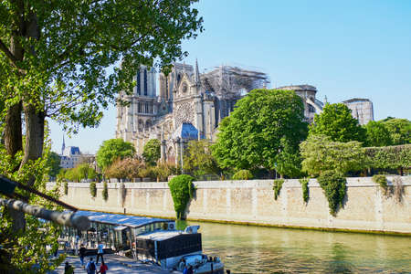 View of Notre Dame cathedral without roof and spire destroyed by fire in Paris, France Imagens