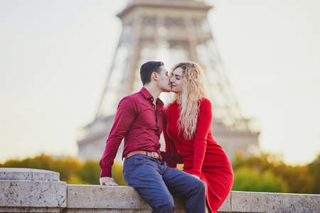 Romantic couple in love near the Eiffel tower in Paris, France