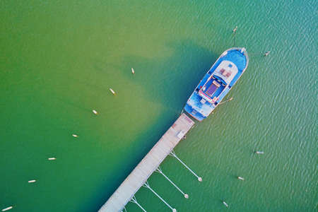Scenic top down view of colorful boats near wooden berth in the countryside of Finland