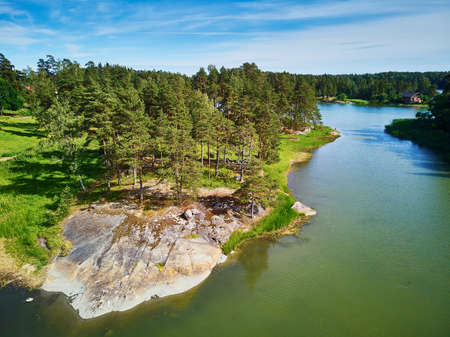 Scenic aerial view pine forest on the rock in the countryside of Finland Stok Fotoğraf