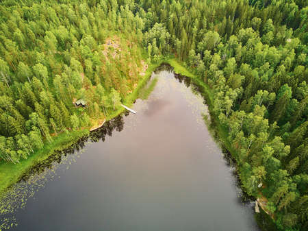 Scenic aerial view of Helgtrask lake in Sipoonkorpi national park of Finland