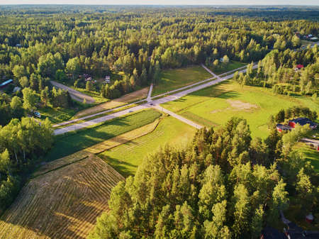 Aerial view of road surrounded by forest in typical countryside of Finland, Northern Europe Banco de Imagens - 127134651