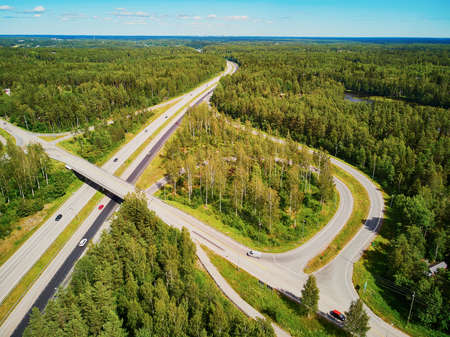 Aerial view of road interchange surrounded by forest in the countryside of Finland, Northern Europe Reklamní fotografie