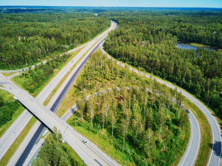 Aerial view of road interchange surrounded by forest in the countryside of Finland, Northern Europe 版權商用圖片