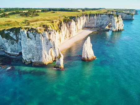 Picturesque panoramic landscape of white chalk cliffs and natural arches of Etretat, Seine-Maritime department of Normandy in France.