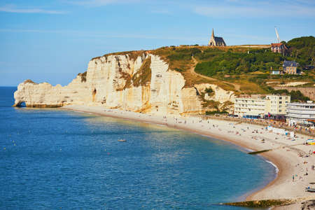 Picturesque panoramic landscape of white chalk cliffs and natural arches of Etretat, Seine-Maritime department of Normandy in France Stock Photo