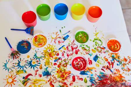 Pots with colorful dye used for fingerpainting. Indoor creative art for kids Reklamní fotografie