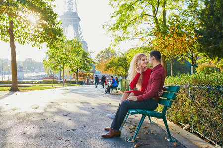 Romantic couple in love near the Eiffel tower in Paris, France Reklamní fotografie