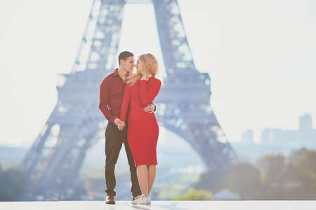 Romantic couple in love near the Eiffel tower in Paris, France Stock fotó