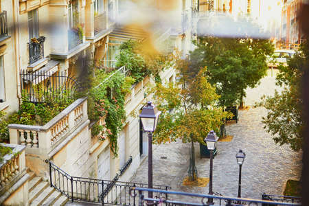 Beautiful street with stairs and lanterns on famous Montmartre hill in Paris, France, taken at early morning