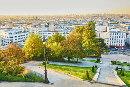 Scenic view to city roofs from famous Montmartre hill in Paris, France, taken at early morning