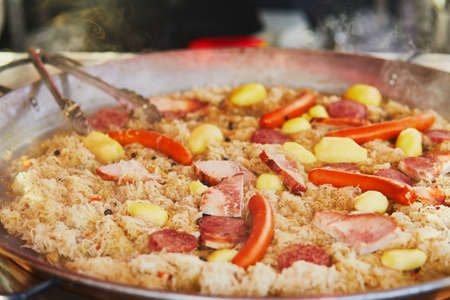 Delicious sauerkraut with smoked sausages on traditional Christmas market in Paris, France Stock Photo