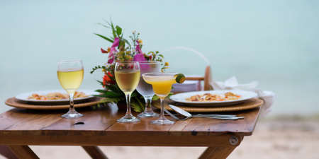 Romantic dinner for two with margarita cocktail served on a beach