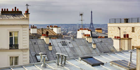 Scenic view of Parisian roofs and Eiffel tower from Montmartre, focus on the Eiffel tower Stockfoto