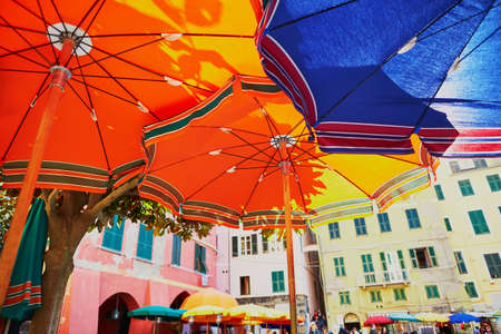 Colorful parasols in Vernazza, one of five famous villages of Cinque Terre in Liguria, Italy