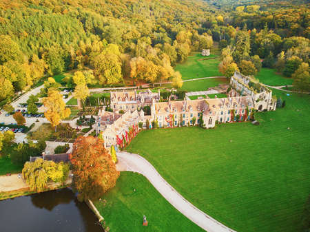 Scenic aerial view of Abbaye des Vaux-de-Cernay, a Cistercian monastery in northern France, situated in Cernay-la-Ville, Yvelines, France 写真素材