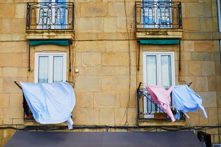 Clothes hanging on a street of San Sebastian (Donostia) in Spain 스톡 콘텐츠 - 138474277