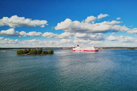 HELSINKI, FINLAND - JUNE 23, 2019: Aerial view of Viking line ferry boat leaving port in Helsinki, Finland