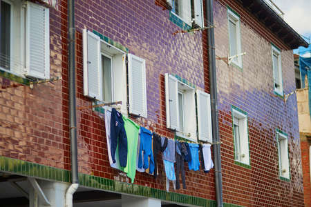 Clothes hanging on a street of San Sebastian (Donostia) in Spain 스톡 콘텐츠 - 138474748