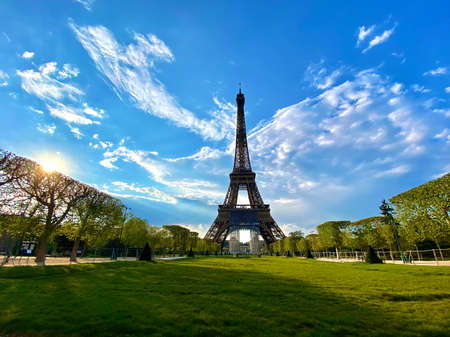 Scenic view of the Eiffel tower with bright blue sky in Paris, France. Empty Parisian streets during coronavirus quarantine and lockdown. Popular tourist destinations Stock Photo