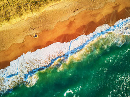Aerial drone view of Atlantic ocean shore line in Brittany, France. Beautiful sea coast with sand beach and huge waves