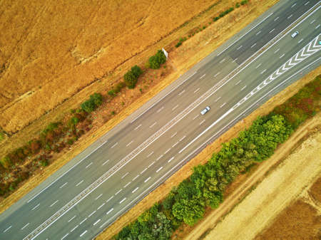 Aerial drone view of beautiful French countryside and six-lane motorway in Brittany, France Stock Photo