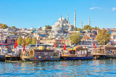 ISTANBUL, TURKEY - October 9th, 2019: View to Eminonu pier and Suleymaniye mosque across Bay of Golden Horn on sunny morning Editorial