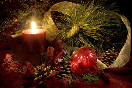 Low key still life of Christmas decorations in reds and greens. photo