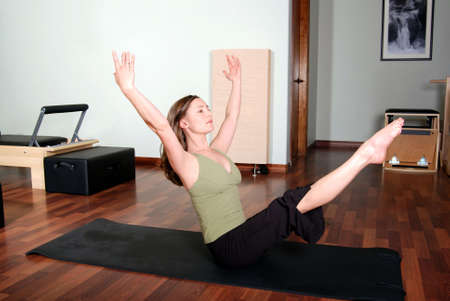 Horizontal image of Pilates Floor Pose by Professional Instructor Imagens - 3953151