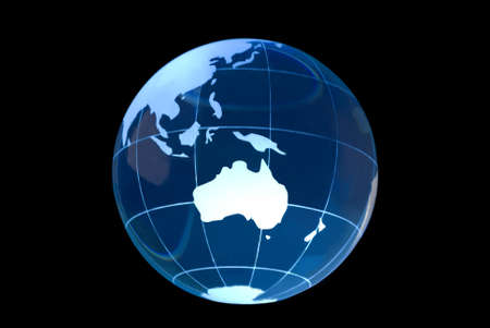 Transparent glass globe on black background with Australia featured.