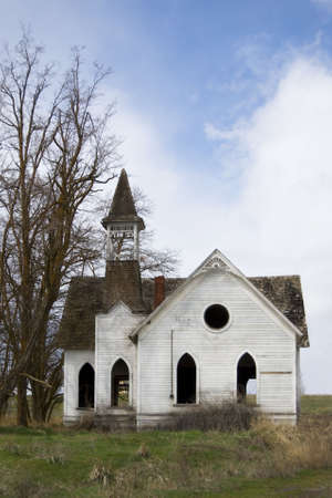 prior: Abandoned, derelict Methodist church in Grass Valley, Oregon, built prior to 1905, abandoned about 1946. Stock Photo