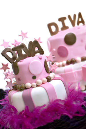 Two pink fondant cakes with Diva spelled out on top and stars garnishing the front cake.  Front cake is in focus, rear cake out of the depth of field.