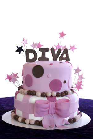 Pink fondant covered two-tier cake with the word Diva spelled out in brown fondant and pink stars.
