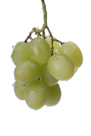 A cluster of green grapes with water droplets against a white background.